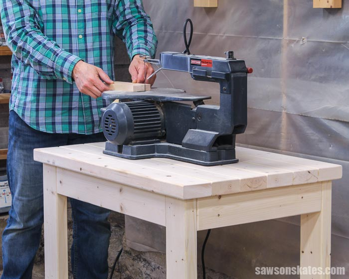 DIY power tool stand with a benchtop scroll saw mounted on top