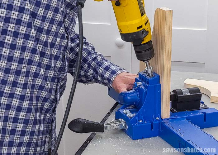 Drilling pocket holes in the side of a wall-mounted DIY paper towel holder