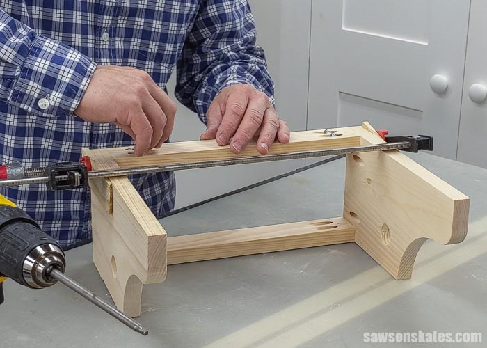 Attaching the back rail of a handmade paper towel holder