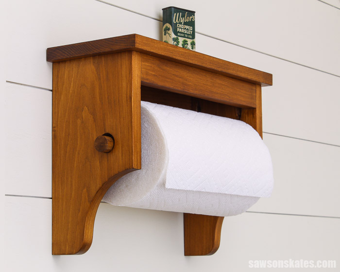 Wood paper towel holder that has been finished with a stain and polyurethane in one