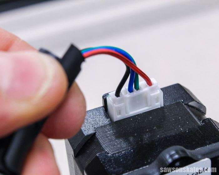 Attaching the wire to the X-axis motor on an Ortur Laser Master 2