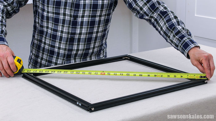 Using a tape measure to make sure the frame of an Ortur Laser Master 2 is square