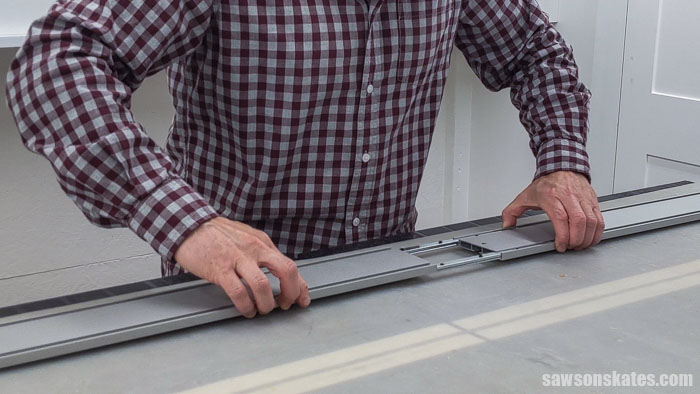 Sliding two guide rails together on a Kreg Straight Edge Guide