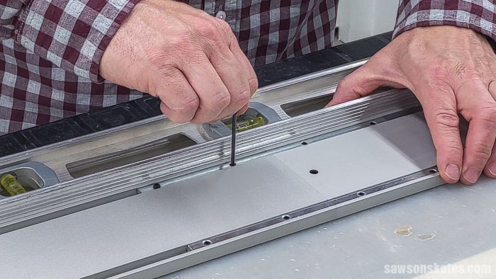 Aligning two guide rail sections on a Kreg Straight Edge Guide with a level