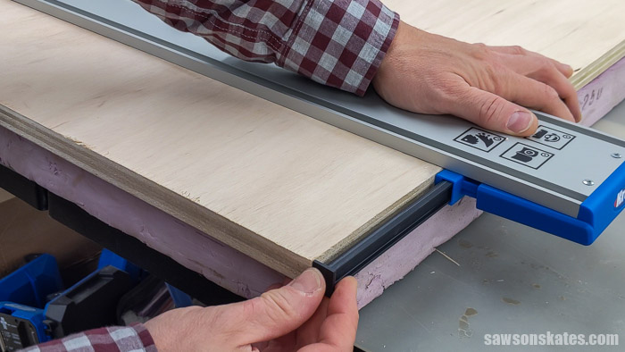 Positioning a cutline indicator arm on a Kreg Straight Edge Guide