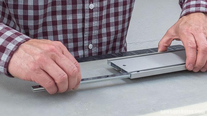Sliding a connector bar into a Kreg Straight Edge Guide