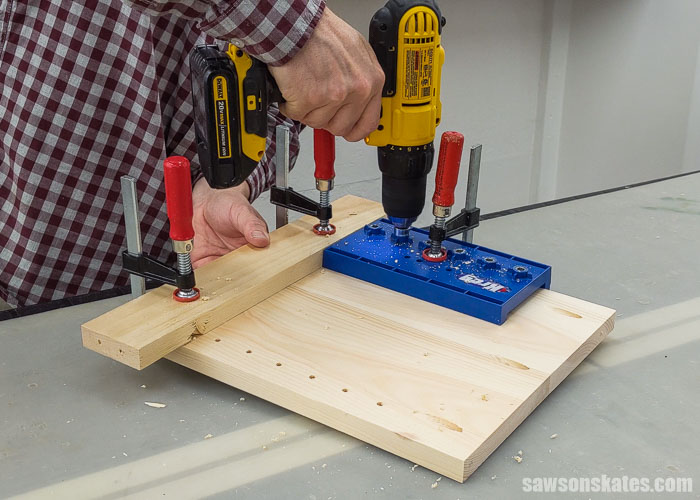 Using a jig to drill shelf pin holes in the side panel of a DIY sander organizer