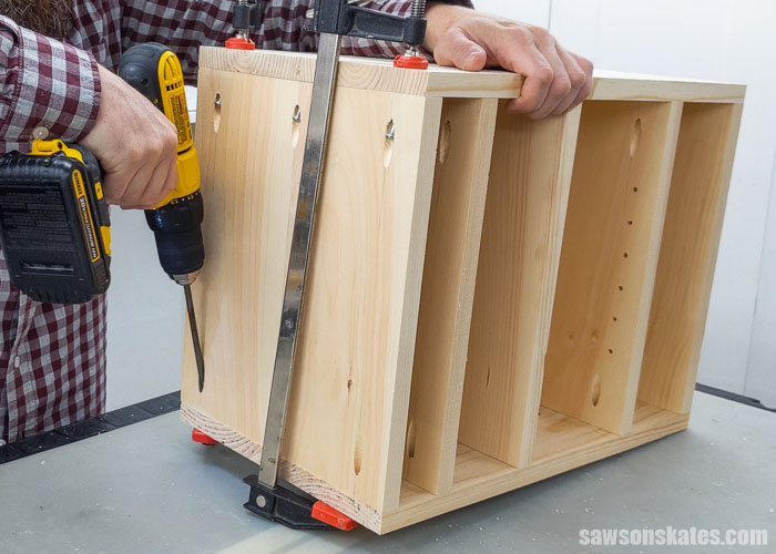 Attaching the last side panel for a DIY sander rack