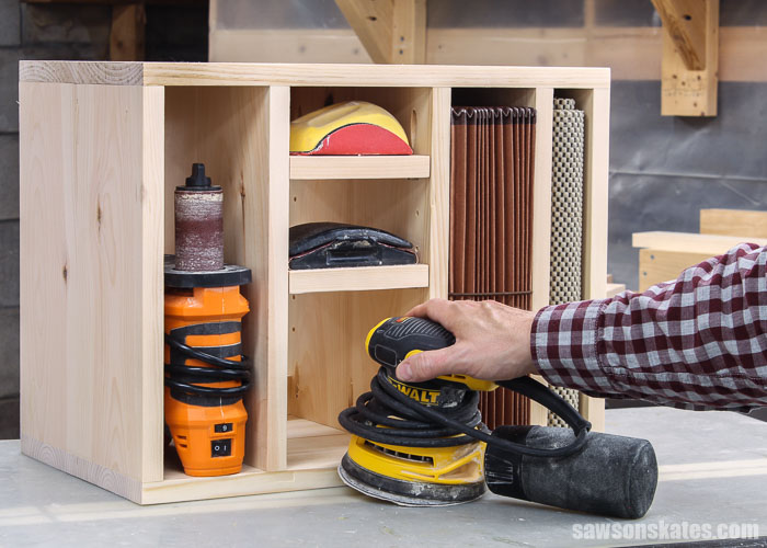 Get your sandpaper and sanders organized with this DIY storage organizer. This sander storage rack is easy to make with a few pieces of wood and these simple plans.