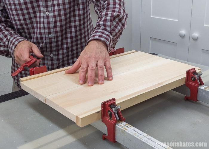 Gluing up side panels for a DIY sander organizer