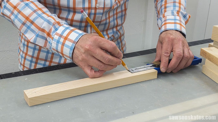 Marking the locations for countersink holes on a DIY yard tool rack