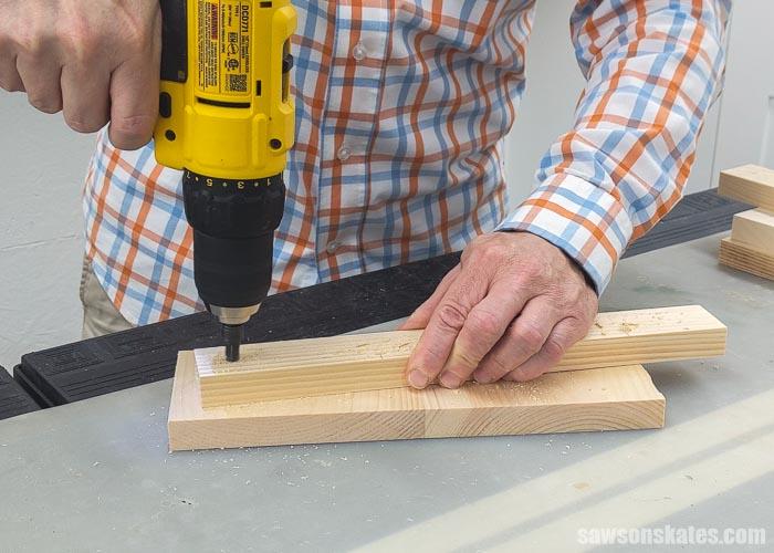 Drilling countersink holes on a DIY yard tool storage rack