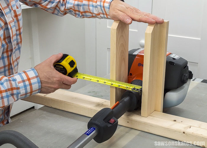 Measuring a tool for a DIY lawn tool storage rack