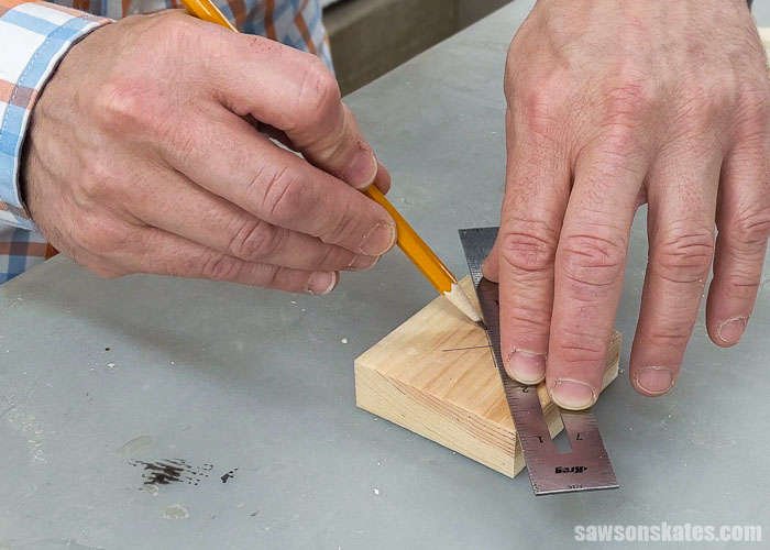 Marking the center of a bracket for DIY garden tool rack