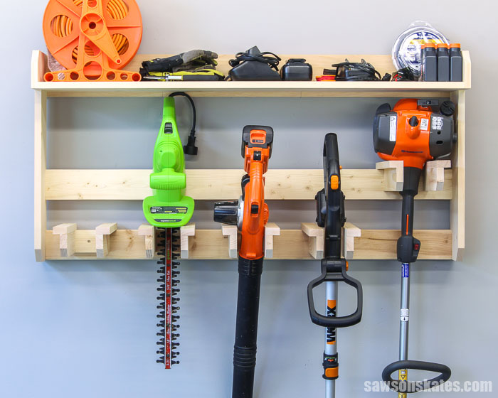 Wall-mounted DIY yard tool rack with lawn tools and supplies