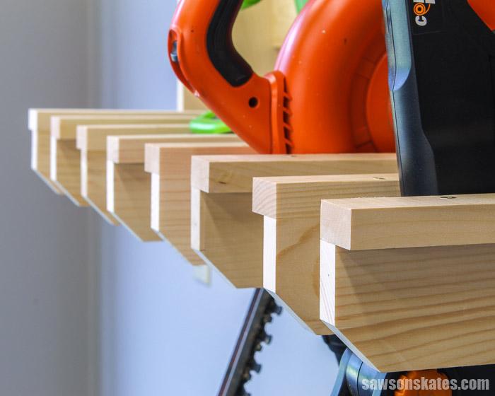 Yard tools organized in a wood DIY lawn tool rack