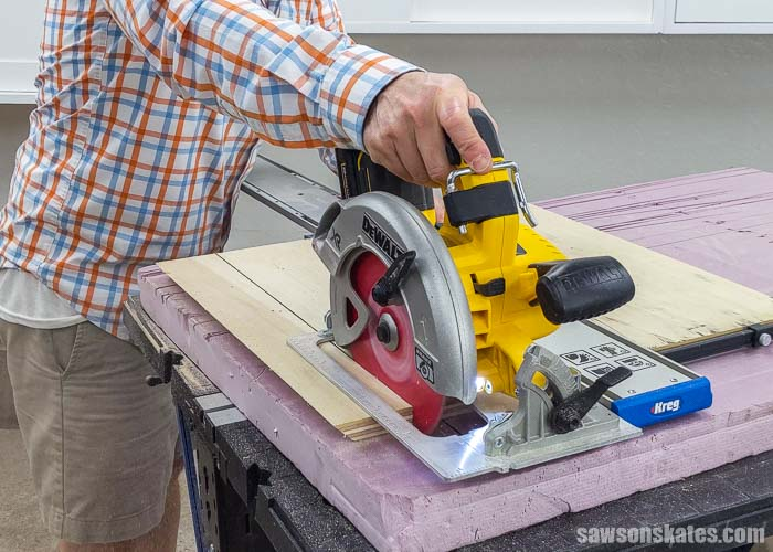 Showing how to use a circular saw to cut the second part of a french cleat