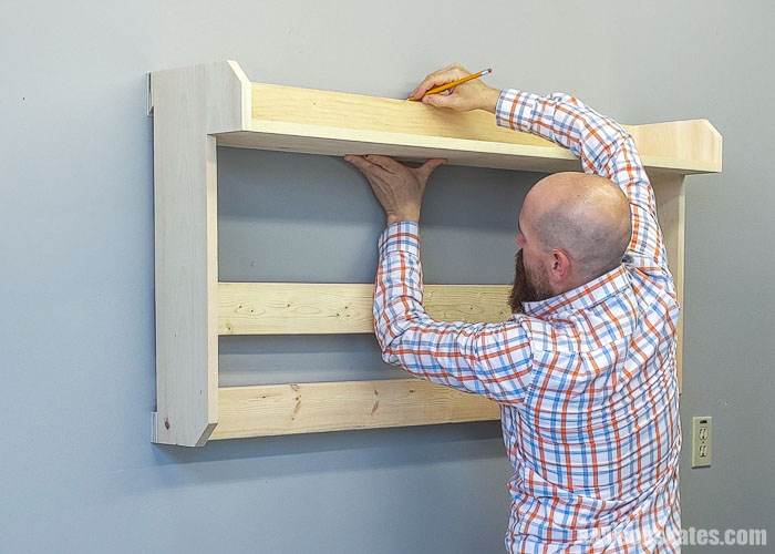Marking where to hang an object on the wall using a french cleat