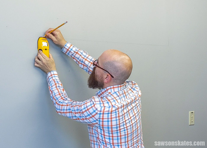 Using a stud finder to install a french cleat