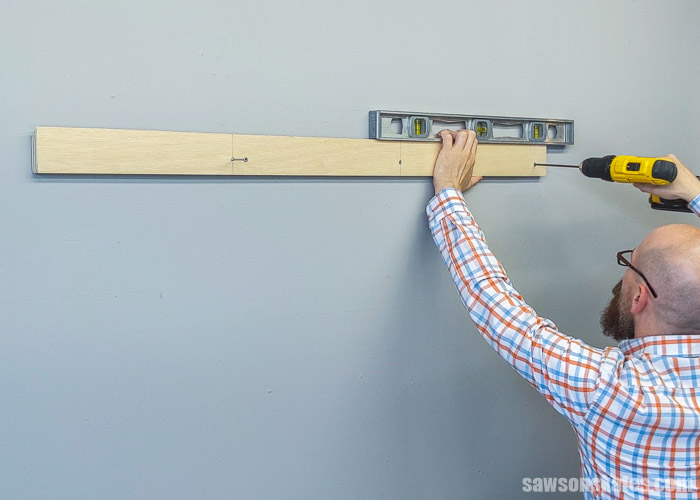 Showing to install a french cleat on the wall