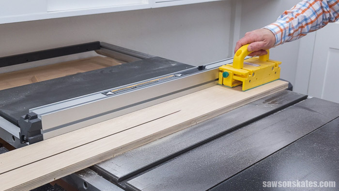 Showing how to use a table saw to make a french cleat