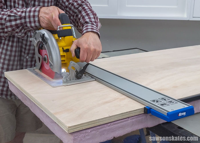 Using a circular saw and a Kreg Straight Edge guide to cut plywood