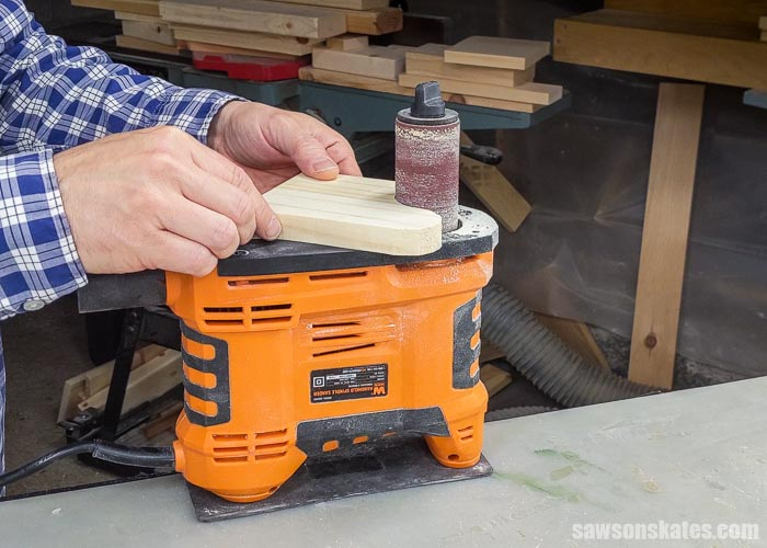 Using a portable spindle sander to sand an inside curve