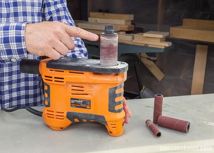 Showing the sandpaper sleeve on a portable spindle sander