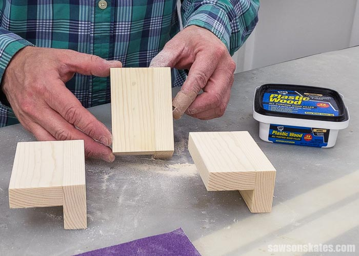 Holding a piece of  wood after using DAP Plastic Wood