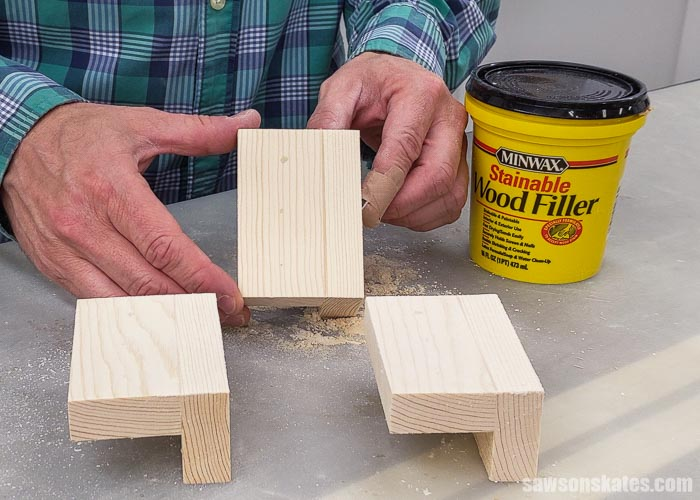 Holding a piece of wood after using Minwax Stainable Wood Filler