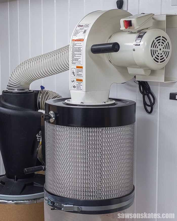 Side view of a wall-mounted dust collector used for a small shop dust collection system.