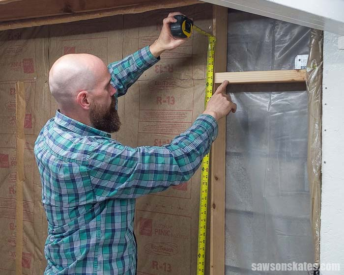Measuring the location of a wall bracket for a wall-mounted dust collector