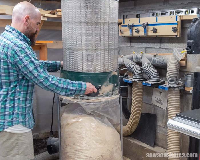 Removing a stationary dust collect to make room for a wall-mount dust collector.